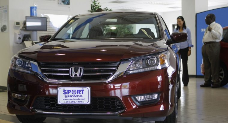 Image: Sales personnel at Sport Honda look over first 2013 Honda Accord to hit showroom floor in Silver Spring, Maryland